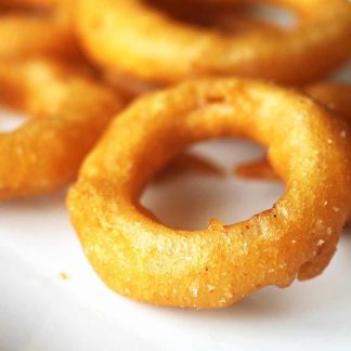 Battered onion rings - your perfect side dish! - Order online today.